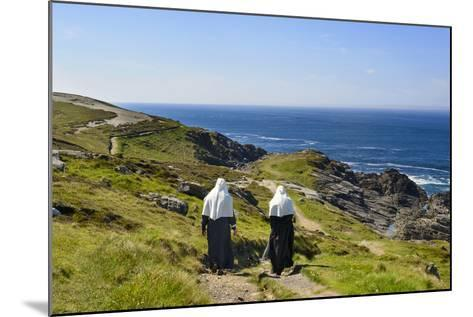 Two Nuns Walking on a Beach in Ireland-Chris Hill-Mounted Photographic Print