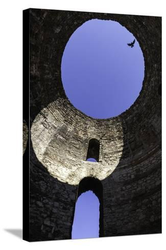A Solitary Bird Flies Above an Opening in a Dome in Diocletian's Palace in Split-Jonathan Irish-Stretched Canvas Print