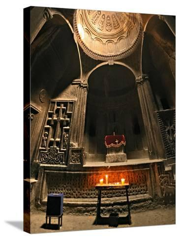 Candles Lit before an Altar in Geghard Monastery. the Monastery Is Carved into a Mountainside-Babak Tafreshi-Stretched Canvas Print