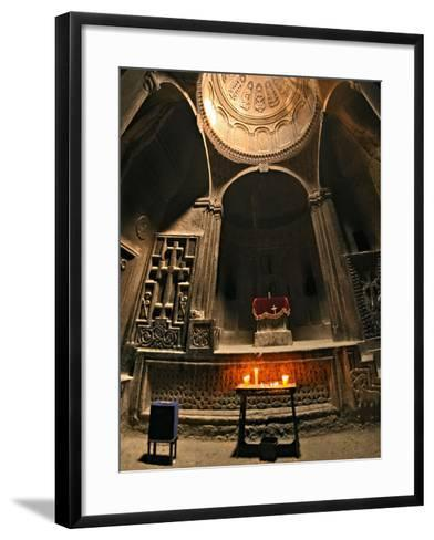 Candles Lit before an Altar in Geghard Monastery. the Monastery Is Carved into a Mountainside-Babak Tafreshi-Framed Art Print