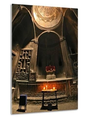 Candles Lit before an Altar in Geghard Monastery. the Monastery Is Carved into a Mountainside-Babak Tafreshi-Metal Print