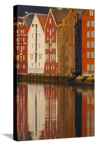 Old Fishing Warehouses Reflected in the River Nidelva-Doug Pearson-Stretched Canvas Print
