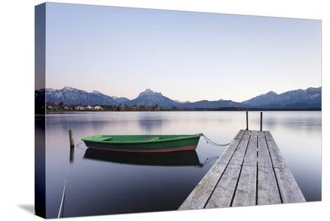 Rowing Boat on Hopfensee Lake at Sunset, Near Fussen, Allgau, Allgau Alps, Bavaria, Germany, Europe-Markus Lange-Stretched Canvas Print