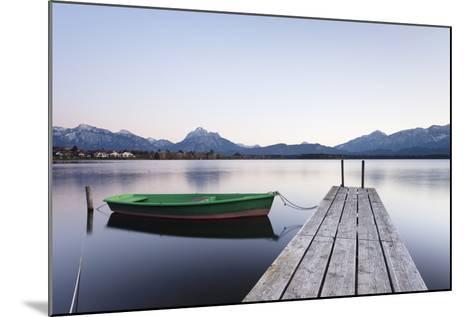 Rowing Boat on Hopfensee Lake at Sunset, Near Fussen, Allgau, Allgau Alps, Bavaria, Germany, Europe-Markus Lange-Mounted Photographic Print