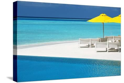 Infinity Pool and Lounge Chairs, Maldives, Indian Ocean, Asia-Sakis Papadopoulos-Stretched Canvas Print