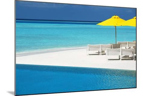 Infinity Pool and Lounge Chairs, Maldives, Indian Ocean, Asia-Sakis Papadopoulos-Mounted Photographic Print