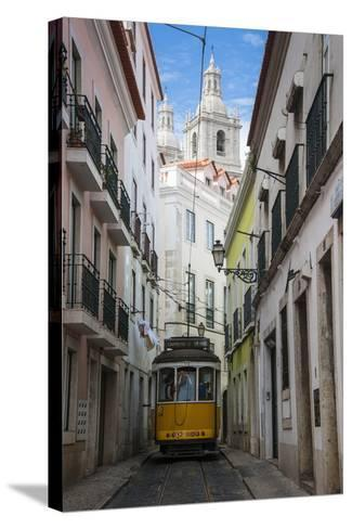 Famous Tram 28 Going Through the Old Quarter of Alfama, Lisbon, Portugal, Europe-Michael Runkel-Stretched Canvas Print