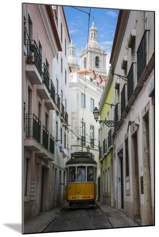 Famous Tram 28 Going Through the Old Quarter of Alfama, Lisbon, Portugal, Europe-Michael Runkel-Mounted Photographic Print