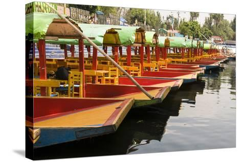 Line of Colourful Boats at the Floating Gardens in Xochimilco-John Woodworth-Stretched Canvas Print