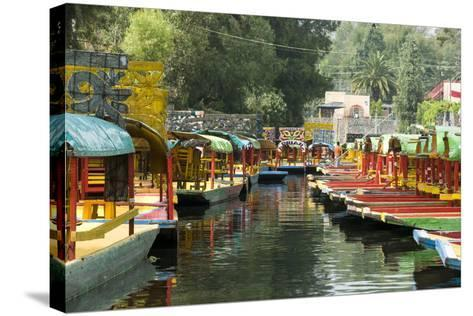 Colourful Boats at the Floating Gardens in Xochimilco-John Woodworth-Stretched Canvas Print