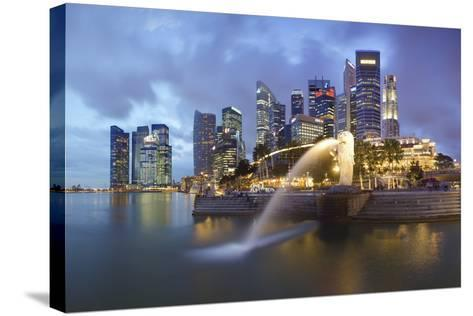 The Merlion Statue with the City Skyline in the Background-Gavin Hellier-Stretched Canvas Print
