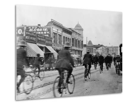 Los Angeles Police Officers Bicycling Past Broadway Storefronts--Metal Print