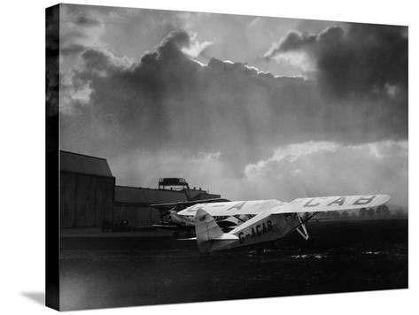 """Amy Johnson's """"The Desert Cloud"""" Preparing for Take Off--Stretched Canvas Print"""