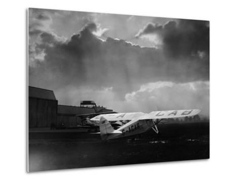 "Amy Johnson's ""The Desert Cloud"" Preparing for Take Off--Metal Print"