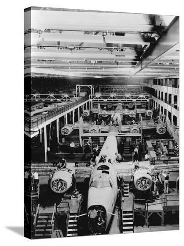 Assembly of B-24 Bombers at Willow Run Plant--Stretched Canvas Print