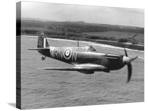 Spitfire in Flight--Stretched Canvas Print