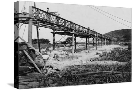 Men Build a Railway Bridge--Stretched Canvas Print