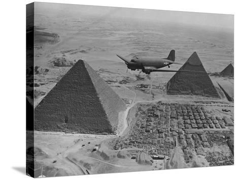 Army Supply Plane over the Pyramids--Stretched Canvas Print