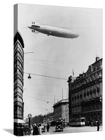 Graf Zeppelin Ii over Berlin--Stretched Canvas Print