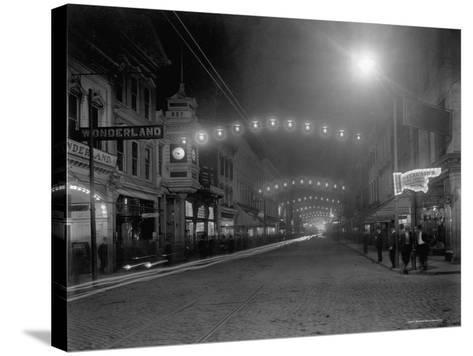 King Street, Charleston, South Carolina at Night--Stretched Canvas Print