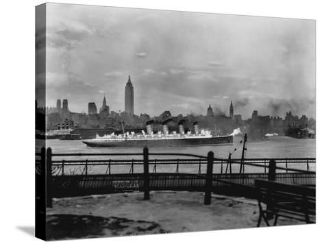 The S.S. Mauretania and New York City Skyline--Stretched Canvas Print