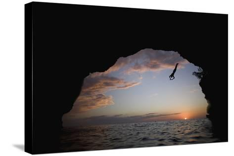 Young Man Diving into Sea at Pirate's Cave-Paul Souders-Stretched Canvas Print