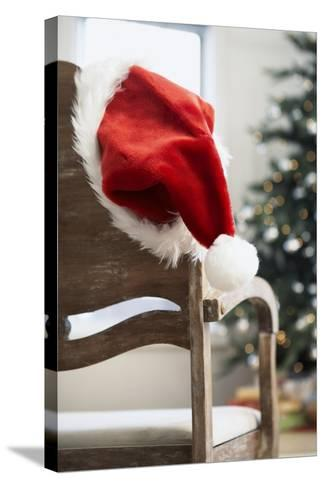 Santa Hat on Chair-Pauline St^ Denis-Stretched Canvas Print