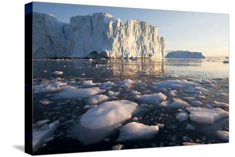 Icebergs in Disko Bay in Greenland-Paul Souders-Stretched Canvas Print