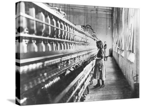 Girl at Spinning Machine-Lewis Wickes Hine-Stretched Canvas Print