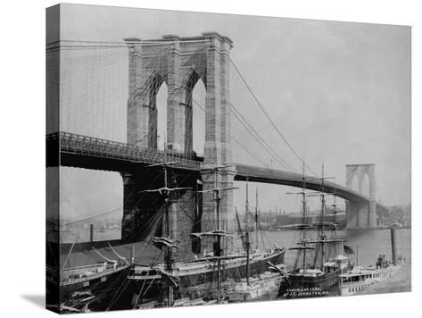 Brooklyn Bridge and Sailing Ships-J.S. Johnston-Stretched Canvas Print