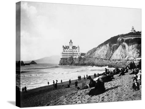 Crowds Enjoy the Beach Below the Cliff House--Stretched Canvas Print