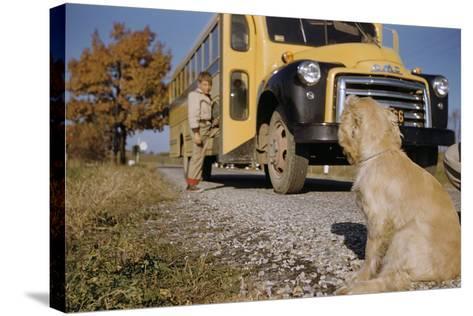 Faithful Dog Watching Boy Enter School Bus-William P^ Gottlieb-Stretched Canvas Print