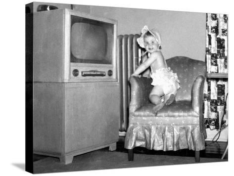 Baby Girl Wants to Watch Television, Ca. 1954--Stretched Canvas Print