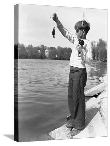 Boy Holding a Small Fish-Philip Gendreau-Stretched Canvas Print