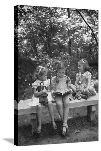 Girls Reading on Park Bench-Philip Gendreau-Stretched Canvas Print
