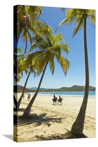 Horse Riders on Beautiful Palm Fringed Playa Carrillo-Rob Francis-Stretched Canvas Print