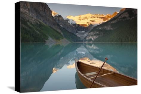 Canoe on Lake Louise at Sunrise-Miles Ertman-Stretched Canvas Print