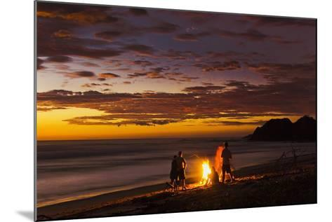 People with Driftwood Fire at Sunset on Playa Guiones Beach-Rob Francis-Mounted Photographic Print