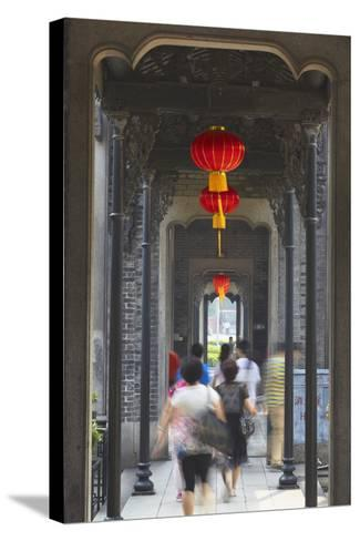 People Walking Along Corridor at Chen Clan Academy, Guangzhou, Guangdong, China, Asia-Ian Trower-Stretched Canvas Print
