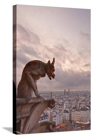 A Gargoyle on Notre Dame De Paris Cathedral Looks over the City, Paris, France, Europe-Julian Elliott-Stretched Canvas Print
