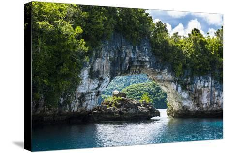 Rock Arch in the Rock Islands, Palau, Central Pacific, Pacific-Michael Runkel-Stretched Canvas Print