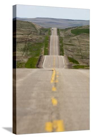 U.S. Highway 85 Through Rolling Prairie in South Dakota-Paul Souders-Stretched Canvas Print