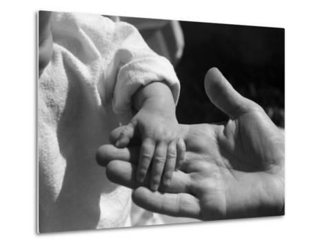 Infant's Hand in Man's Hand-Philip Gendreau-Metal Print