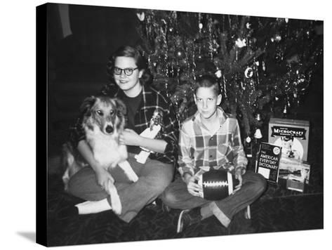 Brother and Sister Pose by the Christmas Tree, Ca. 1960--Stretched Canvas Print