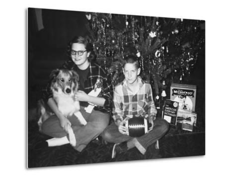 Brother and Sister Pose by the Christmas Tree, Ca. 1960--Metal Print