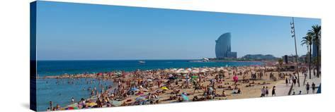 Tourists on the Beach with W Barcelona Hotel in the Background, Barceloneta Beach, Barcelona--Stretched Canvas Print