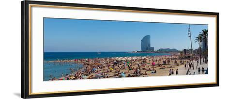 Tourists on the Beach with W Barcelona Hotel in the Background, Barceloneta Beach, Barcelona--Framed Art Print