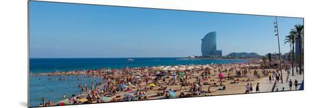 Tourists on the Beach with W Barcelona Hotel in the Background, Barceloneta Beach, Barcelona--Mounted Photographic Print