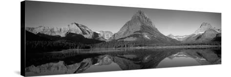 Reflection of Mountains in a Lake, Swiftcurrent Lake, Many Glacier, Us Glacier National Park--Stretched Canvas Print