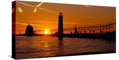 Grand Haven Lighthouse at Sunset, Grand Haven, Michigan, USA--Stretched Canvas Print